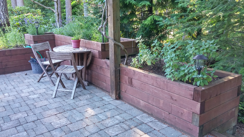 A hardscaped wall and paved patio